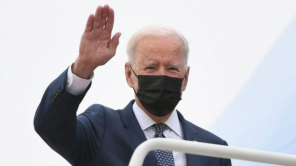 US President Joe Biden waves as he makes his way to board Air Force One before departing from Andrews Air Force Base in Maryland on May 3, 2021. - President Biden is visiting Virginia to promote his Getting America Back on Track Tour.