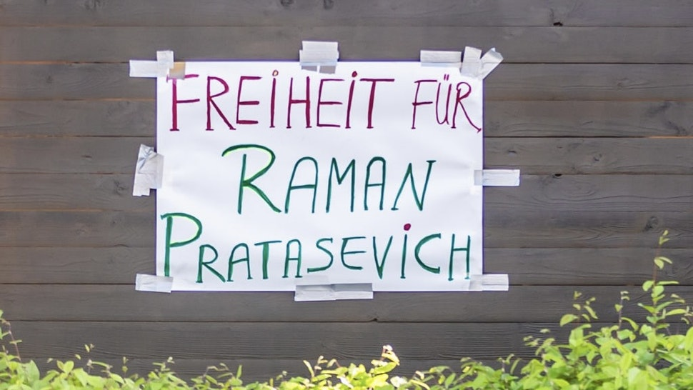 """Embassy of Belarus in Berlin 24 May 2021, Berlin: """"Freedom for Raman Pratasevich"""" (Roman Protashevich) is written on a protest wagon in front of the Embassy of Belarus in Berlin. The EU has strongly condemned the forced landing of a scheduled flight by Belarusian authorities in Minsk and held out the prospect of sanctions against those responsible. In addition, EU foreign affairs representative Borrell demanded the immediate release of Belarusian journalist Roman Protasevich on behalf of all 27 EU states. Photo: Christoph Soeder/dpa (Photo by Christoph Soeder/picture alliance picture alliance / Contributor via Getty Images)"""
