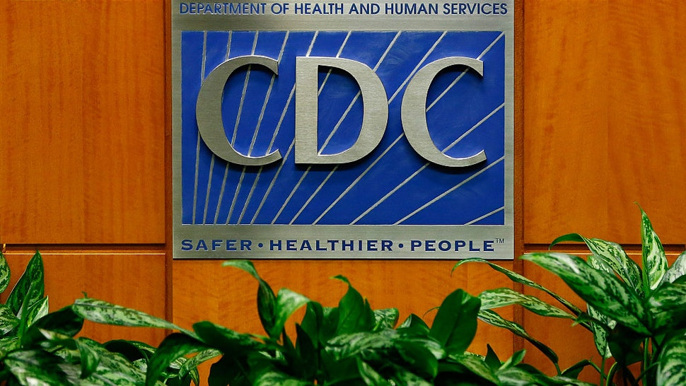 ATLANTA, GA - OCTOBER 05: A podium with the logo for the Centers for Disease Control and Prevention at the Tom Harkin Global Communications Center on October 5, 2014 in Atlanta, Georgia. The first confirmed Ebola virus patient in the United States was staying with family members at The Ivy Apartment complex before being treated at Texas Health Presbyterian Hospital Dallas. State and local officials are working with federal officials to monitor other individuals that had contact with the confirmed patient.