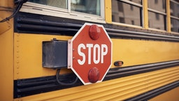 Side view of a school bus and its stop signal - stock photo Side view of a school bus and its stop signal. sandsun via Getty Images