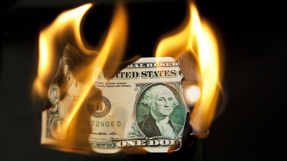 A burning US dollar bill, London, 8th August 2011.