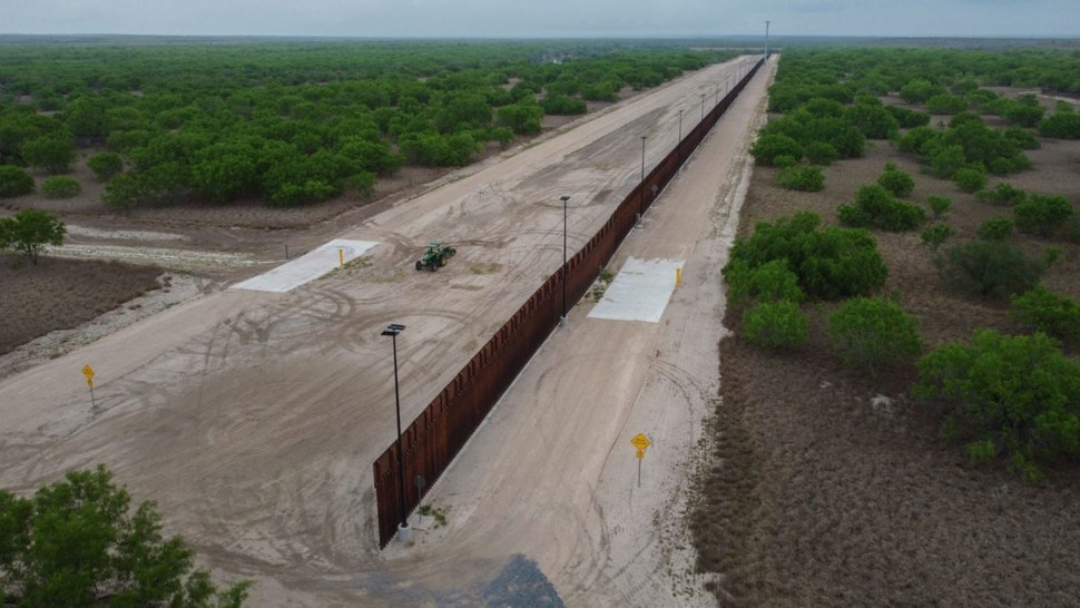 A photo taken on March 30, 2021 shows a general view of an unfinished section of a border wall that former US president Donald Trump tried to build near the southern Texas border city of Roma.