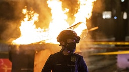 PORTLAND, OR - APRIL 17: Portland Police responds to a structure fire, set by protesters following the police shooting of a homeless man on April 17, 2021 in Portland, Oregon. The shooting comes amid heightened tensions between police and activists as the country awaits a verdict in the trial of Derek Chauvin.