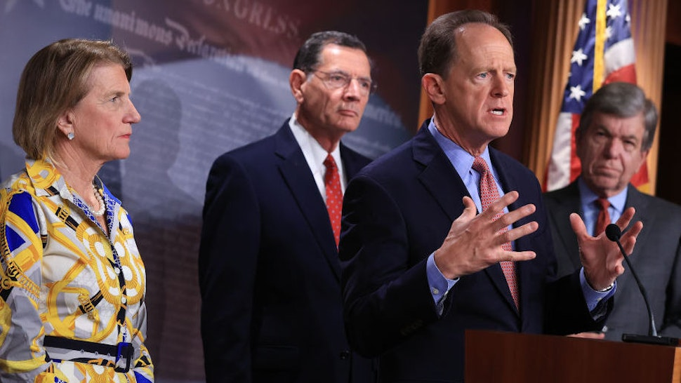 WASHINGTON, DC - MAY 27: Sen. Pat Toomey (R-PA) speaks during a news conference with Sen. Shelley Moore Capito (R-WV) (L), lead Republican negotiator with the Biden administration on infrastructure, Sen. John Barrasso (R-WY) and Sen. Roy Blunt (R-MO) (R) about the GOP's $928 billion counteroffer at the U.S. Capitol on May 27, 2021 in Washington, DC. Insisting that the 2017 Trump tax cuts remain untouched, Senate Republicans suggested that money not spent as part of the COVID-19 American Rescue Plan be diverted to infrastructure.