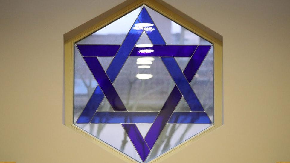 08 November 2018, Mecklenburg-Western Pomerania, Schwerin: The Star of David in a window in the new synagogue of the Jewish community. Photo: Bernd Wüstneck/dpa-Zentralbild/ZB