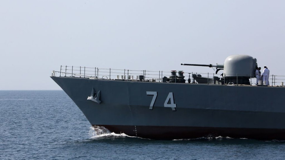 """An Iranian Navy warship takes part in the """"National Persian Gulf day"""" in the Strait of Hormuz, on April 30, 2019. - The date coincides with the anniversary of a successful military campaign by Shah Abbas the Great of Persia in the 17th century, which drove the Portuguese navy out of the Hormuz Island, after which is named the waterway which separates the Gulf from the Sea of Oman. (Photo by ATTA KENARE / AFP) (Photo credit should read ATTA KENARE/AFP via Getty Images)"""