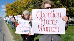 395471 03: Pro-life supporters gather along a two-mile stretch of Woodward Avenue October 7, 2001 in Royal Oak, Michigan. Approximately 2,000 abortions are performed in the United States each day. (Photo by Bill Pugliano/Getty Images)