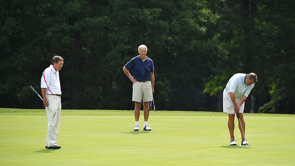 House Speaker John Boehner (R) putts on the first hole watched by Ohio Governor John Kasich (L), and Vice President Joe Biden during a game of golf June 18, 2011 at Andrews Air Force Base in Maryland. AFP PHOTO/Mandel NGAN (Photo credit should read MANDEL NGAN/AFP via Getty Images)