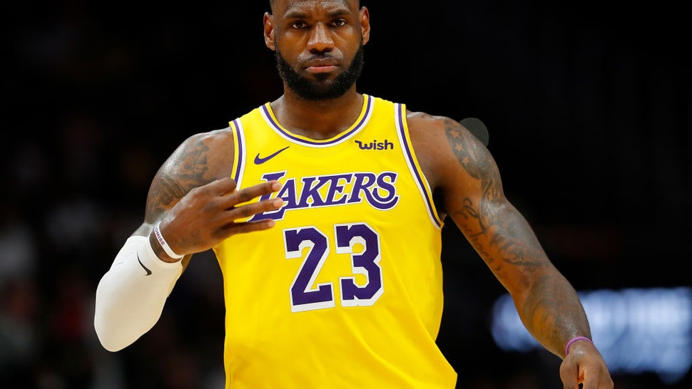 ATLANTA, GEORGIA - DECEMBER 15: LeBron James #23 of the Los Angeles Lakers reacts after hitting a three-point basket against the Atlanta Hawks in the second half at State Farm Arena on December 15, 2019 in Atlanta, Georgia. NOTE TO USER: User expressly acknowledges and agrees that, by downloading and/or using this photograph, user is consenting to the terms and conditions of the Getty Images License Agreement. (Photo by Kevin C. Cox/Getty Images)