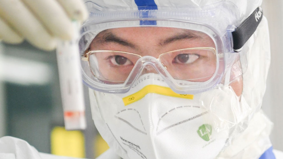 WUHAN, Feb. 13, 2020 -- A staff member works in a laboratory in Wuhan, central China's Hubei Province, Feb. 13, 2020. As a designated service provider of nucleic acid detection of the novel coronavirus, KingMed Diagnostics laboratory in Wuhan conducts non-stop detection service and detects over 2,000 samples from various cities in Hubei Province every day. (Photo by Cheng Min/Xinhua via Getty Images)