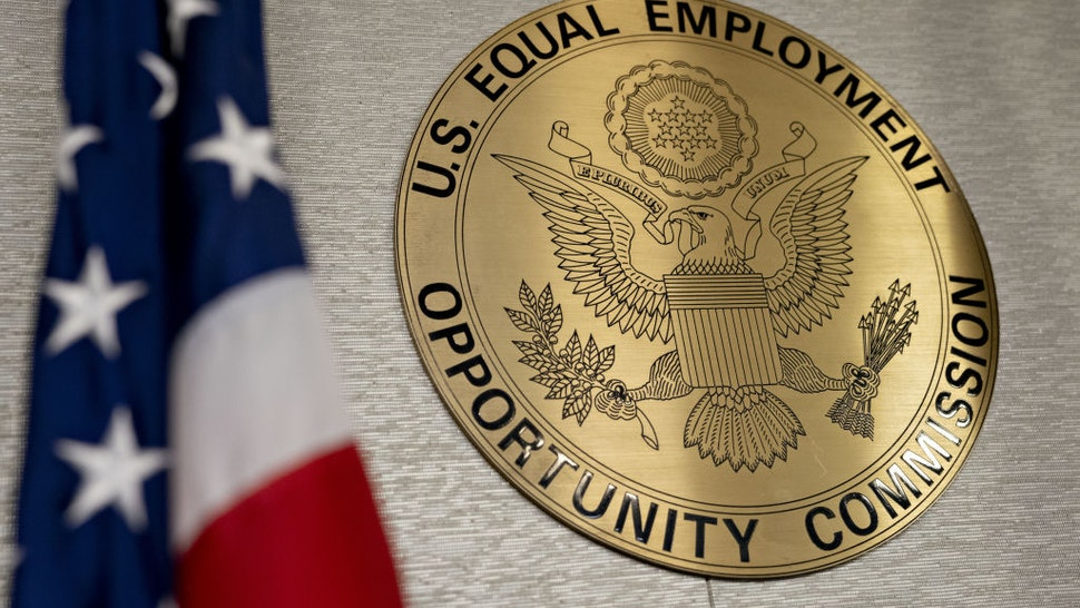 The Equal Employment Opportunity Commission (EEOC) seal hangs inside a hearing room at the headquarters in Washington, D.C., U.S., on Tuesday, Feb. 18, 2020. The Trump administration wants to cut fiscal year 2021 spending on the Labor Department, National Labor Relations Board, and EEOC, reviving previous belt-tightening bids that have not been approved by Congress.