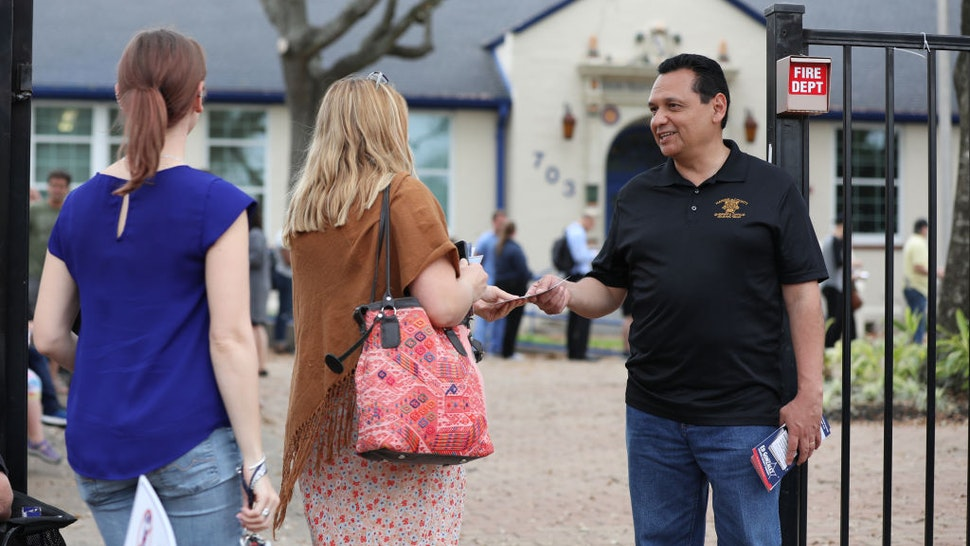 Ed Gonzalez, sheriff seeking re-election for Harris County, speaks to voters outside a polling station in Field Elementary School in Houston, Texas, U.S., on Tuesday, March 3, 2020.