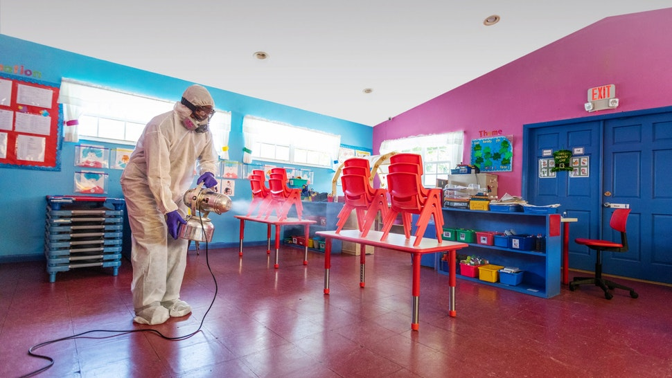 A classroom being sanitized.