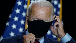 WILMINGTON, DE - AUGUST 13: Presumptive Democratic presidential nominee former Vice President Joe Biden puts his mask back on after delivering remarks following a coronavirus briefing with health experts at the Hotel DuPont on August 13, 2020 in Wilmington, Delaware. Harris is the first Black woman and first person of Indian descent to be a presumptive nominee on a presidential ticket by a major party in U.S. history.