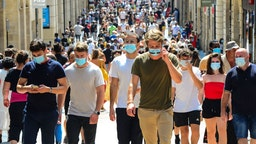 TOPSHOT - People stroll down Bordeaux's main shopping street Sainte-Catherine, where wearing a mask is compulsory as of August 15, 2020, to prevent the spread of the novel coronavirus COVID-19. - The fine for non-compliance with wearing a mask is 135 euros. The Mayor of the southwestern city of Bordeaux Pierre Hurmic, has made it compulsory to wear a mask in Sainte-Catherine and Porte-Dijeaux streets as of from August 15. (Photo by MEHDI FEDOUACH / AFP) (Photo by MEHDI FEDOUACH/AFP via Getty Images)