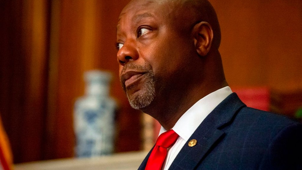 Sen. Tim Scott (R-SC) is seen as he participates in a photo op with President Donald Trumps Supreme Court nominee Judge Amy Coney Barrett prior to their meeting in the US Capitol on September 30, 2020, in Washington, DC.