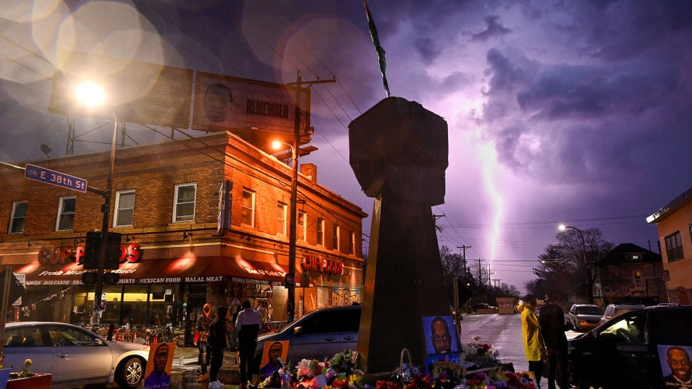 MINNEAPOLIS, MN - APRIL 6: Lighting strikes near the intersection of Chicago Avenue and 38th Street, also know as George Floyd Square on April 6, 2021 in Minneapolis, Minnesota.