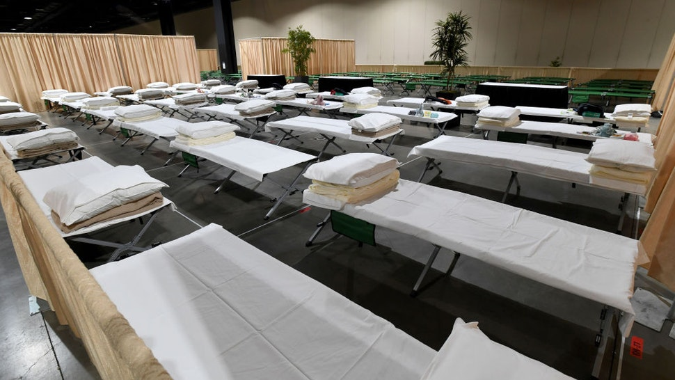 ONG BEACH, CA - APRIL 22: Sleeping quarters set up inside Exhibit Hall B for migrant children are shown during a tour of the Long Beach Convention Center on April 22, 2021 in in Long Beach, California. Long Beach officials and officials with the U.S. Department of Health and Human Services led the tour. Migrant children found at the border without a parent were scheduled to be temporarily housed at the facility beginning today. Officials say the center can accommodate up to 1,000 children. (Photo by Brittany Murray-Pool/Getty Images