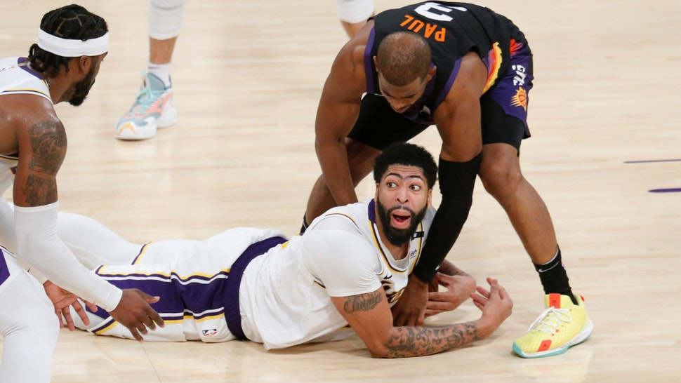 LOS ANGELES, CA - MAY 09: Los Angeles Lakers forward Anthony Davis (3) dives for a loose ball in front ofPhoenix Suns guard Chris Paul (3) Calvin for a time out in the fourth quarter of the Lakers 123-110 win at the Staples Center on Sunday, May 9, 2021 in Los Angeles, CA. (Gary Coronado / Los Angeles Times via Getty Images)