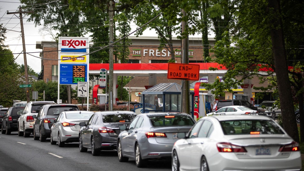 Motorists line up at an Exxon station selling gas at $3.29 per gallon soon after it's fuel supply was replenished in Charlotte, North Carolina on May 12, 2021.
