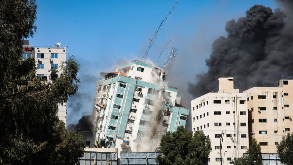 An Israeli airstrike destroys a high-rise building in Gaza City, Gaza Strip, that housed media outlets including The Associated Press and Al Jazeera.