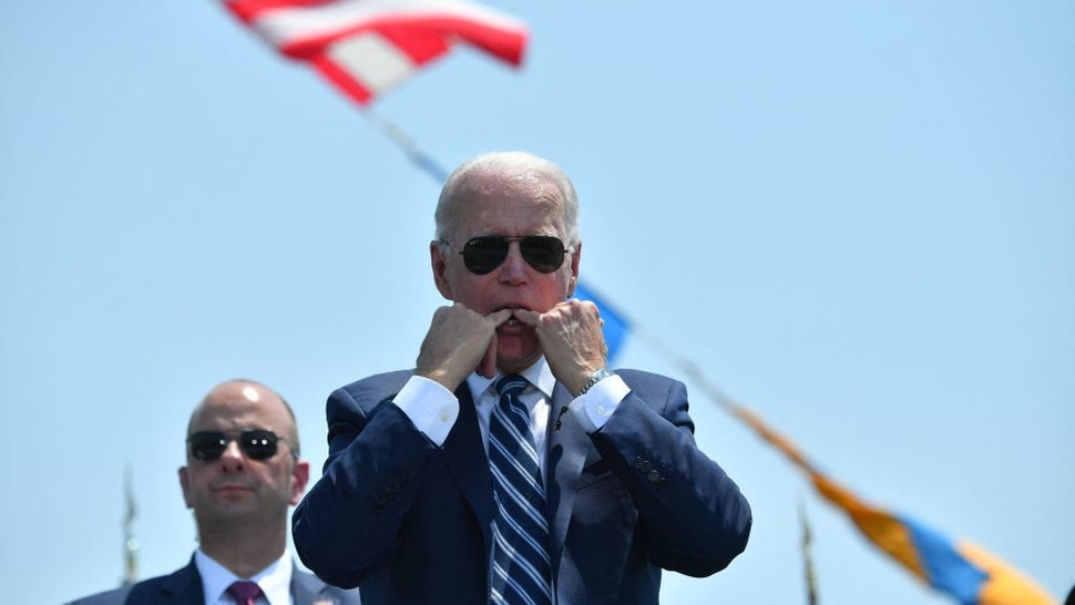 US President Joe Biden whistles during the US Coast Guard Academys 140th commencement exercises on May 19, 2021 in New London, Connecticut.