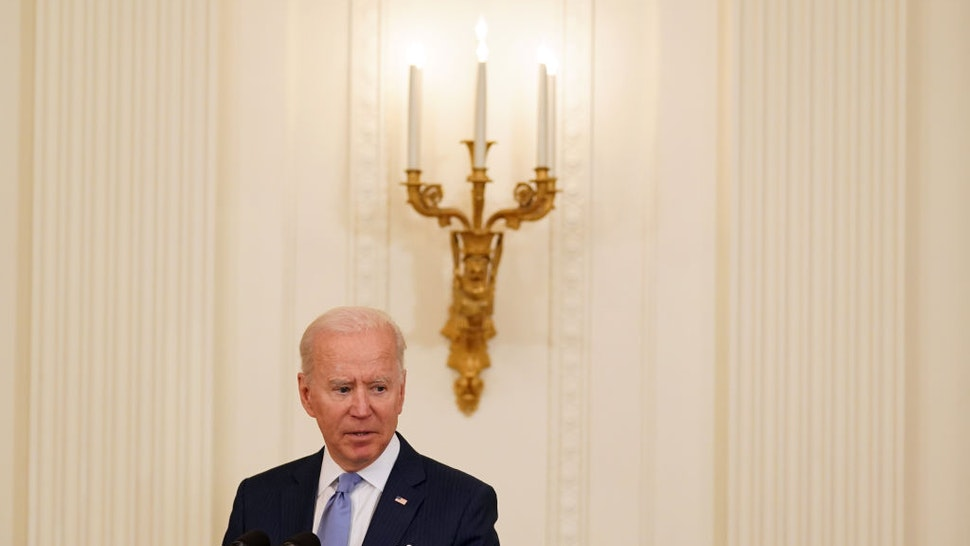 U.S. President Joe Biden speaks before awarding a Medal of Honor to Korean War veteran Army Colonel Ralph Puckett, not pictured, during a ceremony in the East Room of the White House in Washington, D.C., U.S., on Friday, May 21, 2021. South Korean PresidentMoon Jae-in is set to make a last-ditch attempt to bring the U.S. and North Korea together under his watch when he meets Biden, trying to revive dormant nuclear talks in his final year in office. Photographer: Stefani Reynolds/The New York Times/Bloomberg via Getty Images