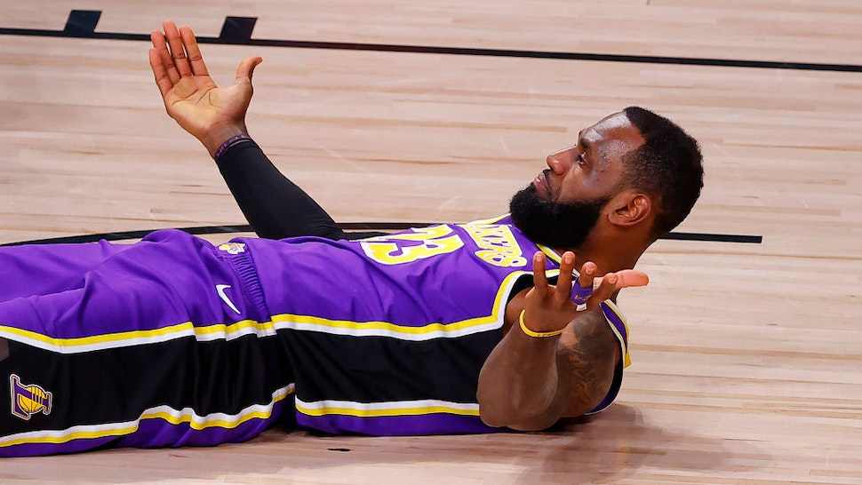 LAKE BUENA VISTA, FLORIDA - SEPTEMBER 26: LeBron James #23 of the Los Angeles Lakers reacts after taking an offensive foul during the first quarter against the Denver Nuggets in Game Five of the Western Conference Finals during the 2020 NBA Playoffs at AdventHealth Arena at the ESPN Wide World Of Sports Complex on September 26, 2020 in Lake Buena Vista, Florida. NOTE TO USER: User expressly acknowledges and agrees that, by downloading and or using this photograph, User is consenting to the terms and conditions of the Getty Images License Agreement. (Photo by Kevin C. Cox/Getty Images)