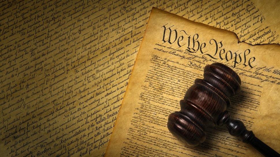 US Constitution with gavel - stock photo