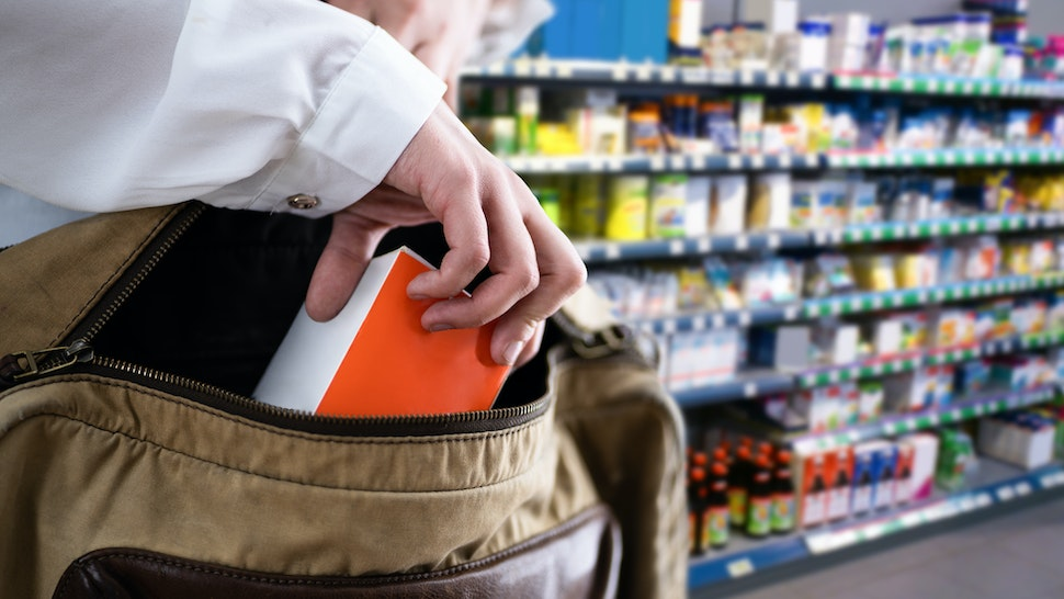 Retail Shoplifting. Woman Stealing In Supermarket. Theft - stock photo