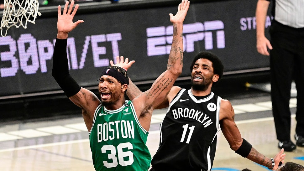 NEW YORK, NEW YORK - MAY 22: Marcus Smart #36 of the Boston Celtics is fouled by Kyrie Irving #11 of the Brooklyn Nets in Game One of the First Round of the 2021 NBA Playoffs at Barclays Center at Barclays Center on May 22, 2021 in New York City. NOTE TO USER: User expressly acknowledges and agrees that, by downloading and or using this photograph, User is consenting to the terms and conditions of the Getty Images License Agreement. (Photo by Steven Ryan/Getty Images)