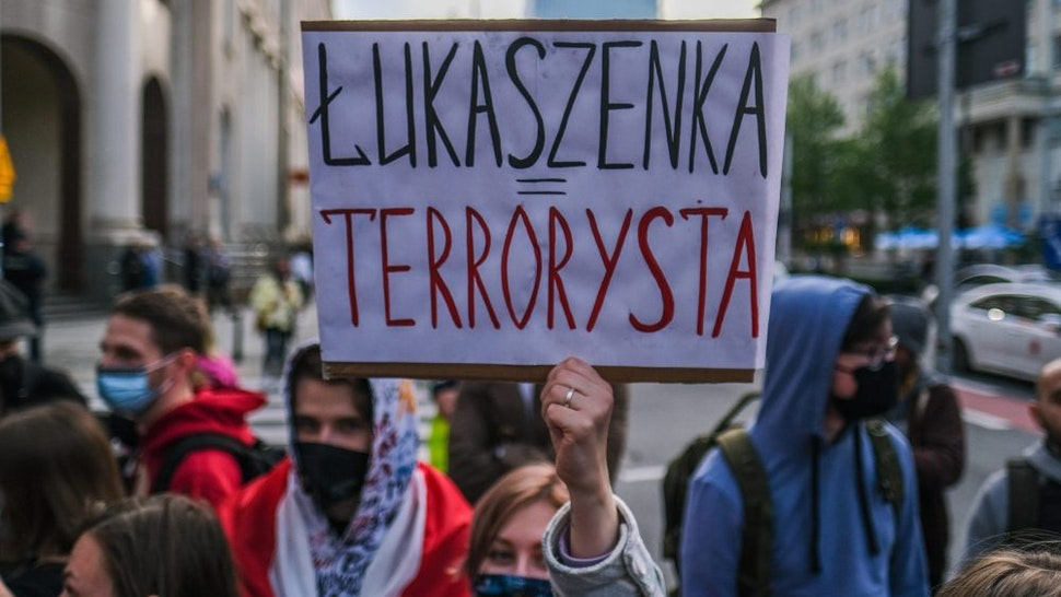 WARSAW, POLAND - MAY 24: People hold banners during a protest against the detention of the Belarusian journalist Roman Protasevich in front of the European Commission representative office on May 24, 2021 in Warsaw, Poland. The demonstration comes the day after Belarusian leader Aleksandr Lukashenko deployed a fighter jet to force a Ryanair flight, en route from Athens to Vilnius, to land in Minsk, where authorities removed dissident Belarusian journalist Roman Protasevich from the flight.