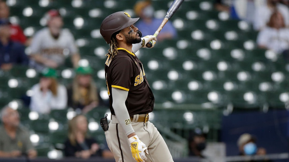 MILWAUKEE, WISCONSIN - MAY 26: Fernando Tatis Jr. #23 of the San Diego Padres hits a run batted in sacrifice fly in the first inning against the Milwaukee Brewers at American Family Field on May 26, 2021 in Milwaukee, Wisconsin. (Photo by John Fisher/Getty Images)