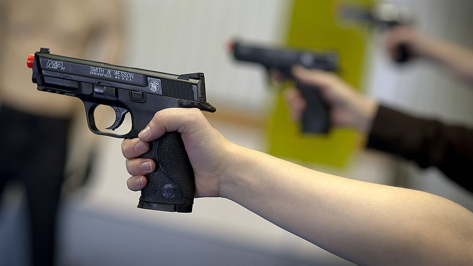Students practice shooting Smith & Wesson Holdings Corp. M&P 40 Airsoft pistol during an all women class at the Oklahoma Personal Defense Academy in Shawnee, Oklahoma, U.S., on Saturday, Nov. 5, 2011. Domestic handgun production and imports more than doubled over four years to about 4.6 million in 2009, according to the National Shooting Sports Foundation, a gun-industry trade group.