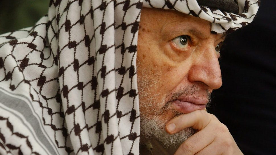 405490 02: Palestinian leader Yasser Arafat attends Friday prayers May 17, 2002 at his headquarters in the West Bank town of Ramallah. Arafat said Friday there could not free Palestinian elections until the Israel military occupation ended in the West Bank and Gaza Strip.
