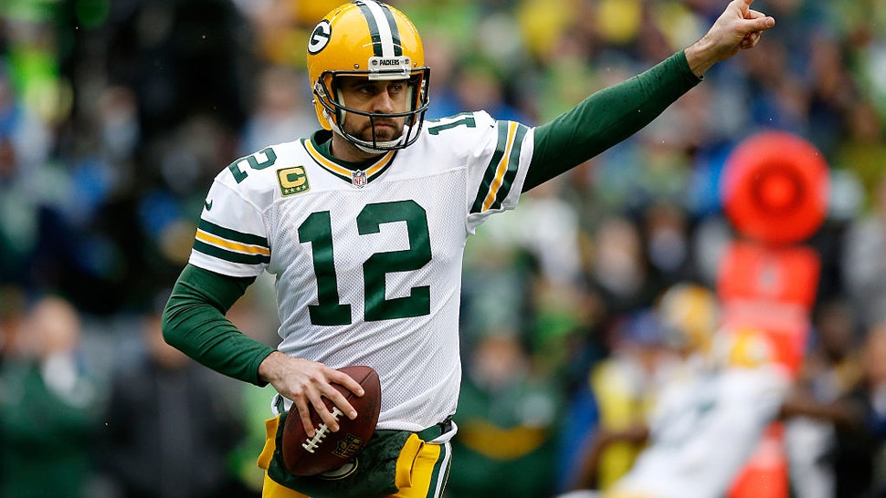 SEATTLE, WA - JANUARY 18: Aaron Rodgers #12 of the Green Bay Packers reacts in the first quarter against the Seattle Seahawks during the 2015 NFC Championship game at CenturyLink Field on January 18, 2015 in Seattle, Washington. (Photo by Otto Greule Jr/Getty Images)