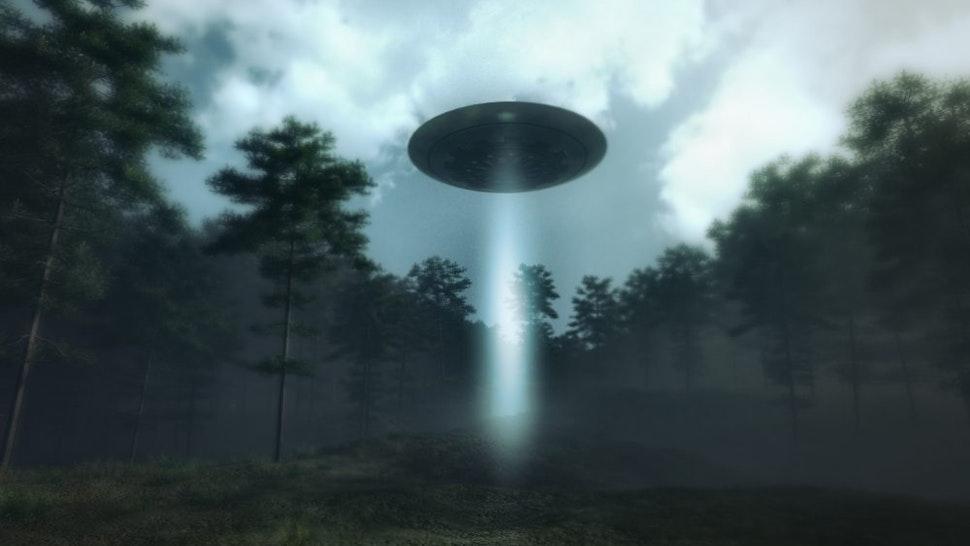 UFO landing in the forest meadow