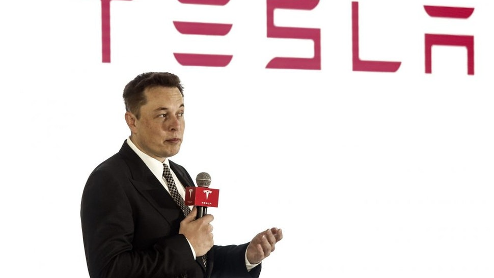 BEIJING, CHINA - OCTOBER 23: (CHINA OUT) Elon Musk, Chairman, CEO and Product Architect of Tesla Motors, addresses a press conference to declare that the Tesla Motors releases v7.0 System in China on a limited basis for its Model S, which will enable self-driving features such as Autosteer for a select group of beta testers on October 23, 2015 in Beijing, China. The v7.0 system includes Autosteer, a new Autopilot feature. While it's not absolutely self-driving and the driver still need to hold the steering wheel and be mindful of road conditions and surrounding traffic when using Autosteer. When set to the new Autosteer mode, graphics on the driver's display will show the path the Model S is following, post the current speed limit and indicate if a car is in front of the Tesla.