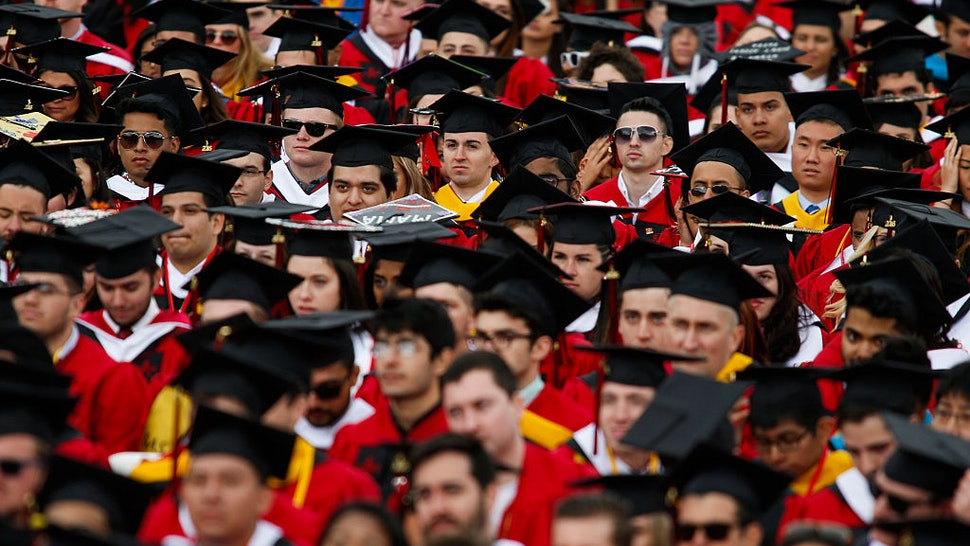 NEW BRUNSWICK, NJ - MAY 15: Students listen to U.S. President Barack Obama while he speaks after receiving an honorary doctorate of laws during the 250th anniversary commencement ceremony at Rutgers University on May 15, 2016 in New Brunswick, New Jersey. Obama is the first sitting president to speak at the school's commencement. (Photo by Eduardo Munoz Alvarez/Getty Images)