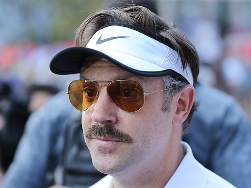 NEW YORK, NY - JUNE 22: Coach Ted Lasso (Jason Sudeikis) speaks with the media following the 2016 Steve Nash Foundation Showdown at Sara D. Roosevelt Park on June 22, 2016 in New York City. (Photo by J. Countess/Getty Images)