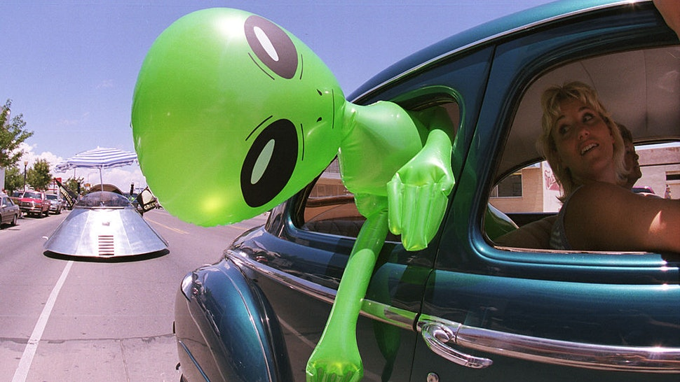"""372049 02: An alien doll hangs out a car window in downtown Roswell, New Mexico July 1, 2000 as part of the annual UFO Encounter, which runs through July 4, 2000. The annual festival stems from a mysterious crash northwest of Roswell in 1947. The Army initially said it was a UFO crash, but quickly backed off that report. The Pentagon has since said it was a top-secret balloon crash, but UFO enthusiasts don''t believe that story, which gives rise to what has become known as the """"Roswell Incident"""". (Photo by Joe Raedle/Newsmakers)372049 02: An alien doll hangs out a car window in downtown Roswell, New Mexico July 1, 2000 as part of the annual UFO Encounter, which runs through July 4, 2000. The annual festival stems from a mysterious crash northwest of Roswell in 1947. The Army initially said it was a UFO crash, but quickly backed off that report. The Pentagon has since said it was a top-secret balloon crash, but UFO enthusiasts don''t believe that story, which gives rise to what has become known as the """"Roswell Incident"""". (Photo by Joe Raedle/Newsmakers)"""