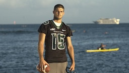 HONOLULU - AUGUST 16: Quarterback Colt Brennan or the University of Hawaii Warriors poses for a photo on Waikiki Beach on August 16, 2007 in Honolulu, Hawaii. (Photo by Lucy Pemoni/Getty Images)