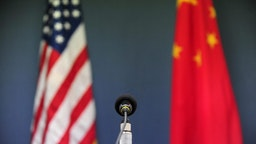 The US and China flags stand behind a microphone awaiting the arrival of US Senator John McCain, who was joined by Senators Lindsey Graham Amy Klobuchar for a press conference at the US Embassy in Beijing on April 9, 2009 during the China stop of the Congressional Delegation's fact-finding Asia-tour. Senator McCain said he urged Chinese officials in talks here to back a strong United Nations response to North Korea's rocket launch, but indicated China had resisted.