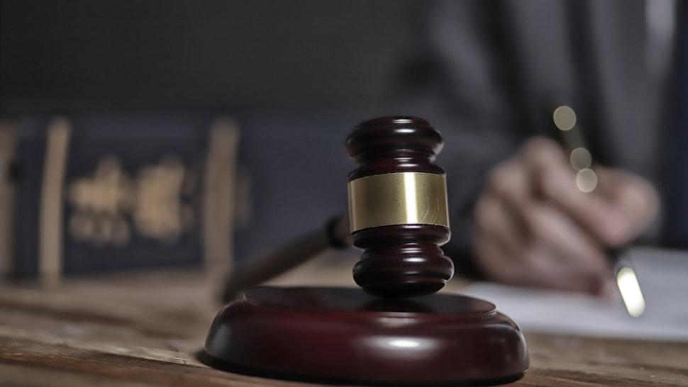 Lawyer writing documents - stock photo