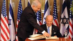 Israeli Prime Minister Benjamin Netanyahu helps US Vice President Joe Biden sign the guestbook at his residence in Jerusalem, March 9, 2010. UPI/Debbie Hill
