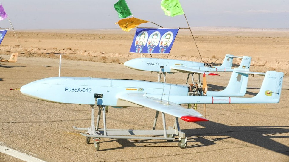 """SEMNAN, IRAN -JANUARY 5: (----EDITORIAL USE ONLY MANDATORY CREDIT - """"IRANIAN ARMY/ HANDOUT"""" - NO MARKETING NO ADVERTISING CAMPAIGNS - DISTRIBUTED AS A SERVICE TO CLIENTS----) Unmanned aerial vehicles (UAV) drill held by Iranian army in Semnan, Iran on January 5, 2021."""