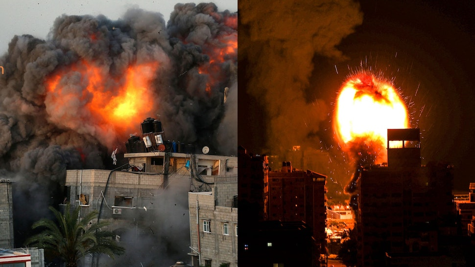 TOPSHOT - A ball of fire and a plume of smoke rise above buildings in Gaza City as Israeli warplanes target the Palestinian enclave, early on May 17, 2021.