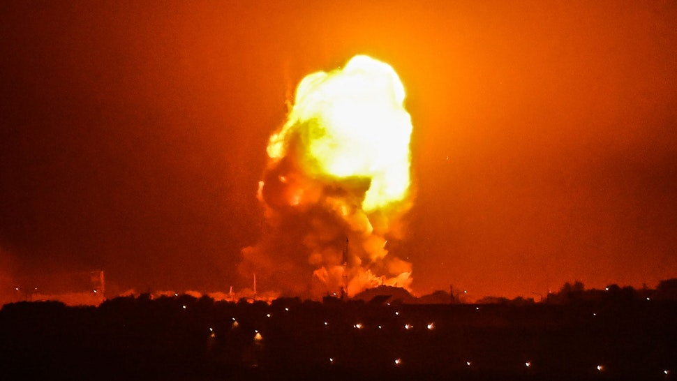 TOPSHOT - Fire billows from Israeli air strikes in Rafah, in the southern Gaza Strip, on May 11, 2021. - Israel launched deadly air strikes on Gaza on May 10 in response to a barrage of rockets fired by Hamas and other Palestinian militants, amid spiralling violence sparked by unrest at Jerusalem's Al-Aqsa Mosque compound.