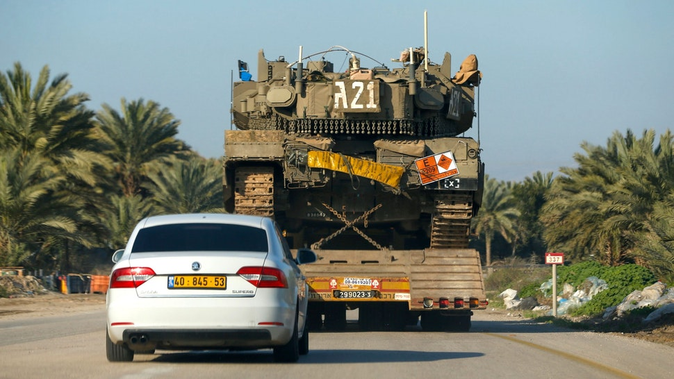 A general view taken on March 3, 2020, shows an Israeli Merkava IV battle tank being transported past an agricultural field near the settlement of Mehola in the Jordan valley in the occupied West Bank.