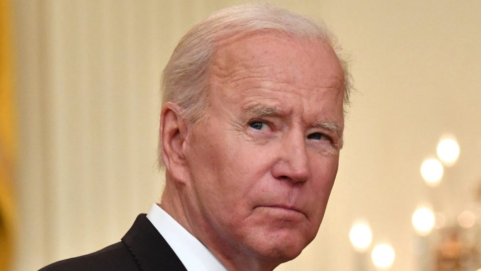 TOPSHOT - US President Joe Biden delivers remarks on the COVID-19 response and the vaccination in the East Room at the White House in Washington, DC on May 17, 2021.